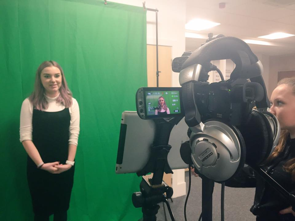 presenting in front of a green screen