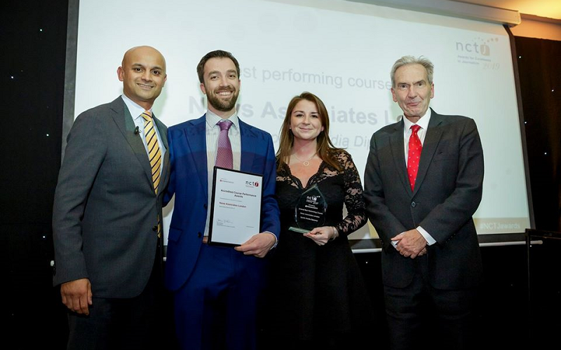 News Associates head of journalism Graham Moody and editorial development manager Lucy Dyer collecting the award for top gold-standard NCTJ journalism course in 2019 from Sky News presenter Dharmesh Sheth and NCTJ chairman Kim Fletcher